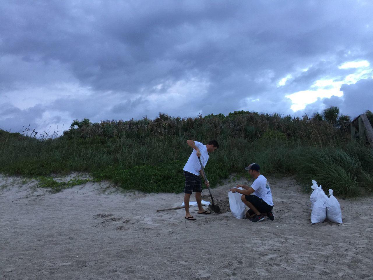 Filling sand bag in preparation for Hurricane Matthew 2016 Melbourne Beach, FL Hurricane Matthew Sand Sand Bags Hurricane Preps