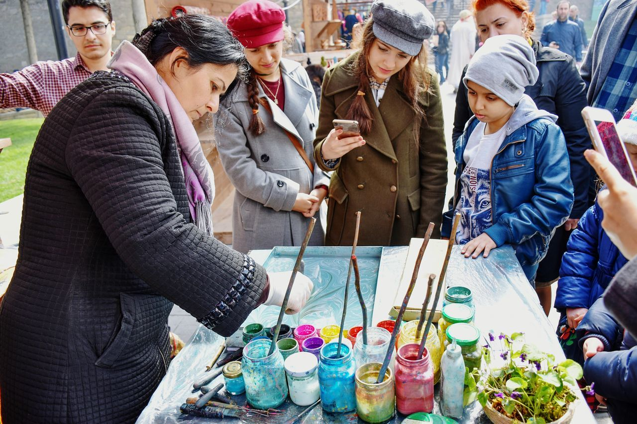 Artist Watercolor Painting Water Colour Painting Painting On Water Warm Clothing People Group Of People City Women Outdoors Market Stall Market Streetphotography Togetherness Leisure Activity Colorful Multi Colored Winter Happiness Fun The Week On EyeEm See The Light