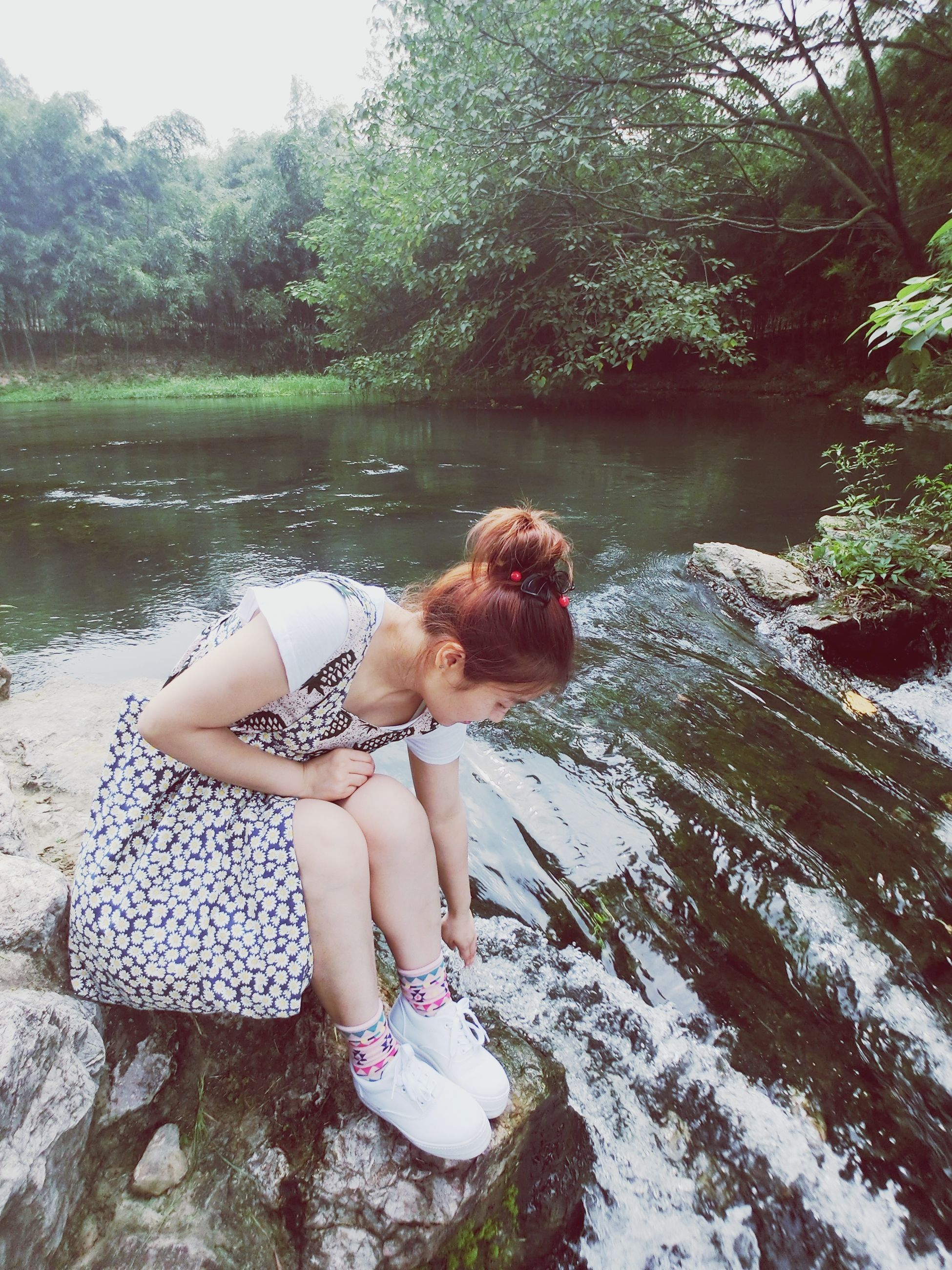 water, tree, leisure activity, lifestyles, person, full length, childhood, young women, young adult, girls, relaxation, sitting, lake, elementary age, casual clothing, nature, three quarter length, tranquility