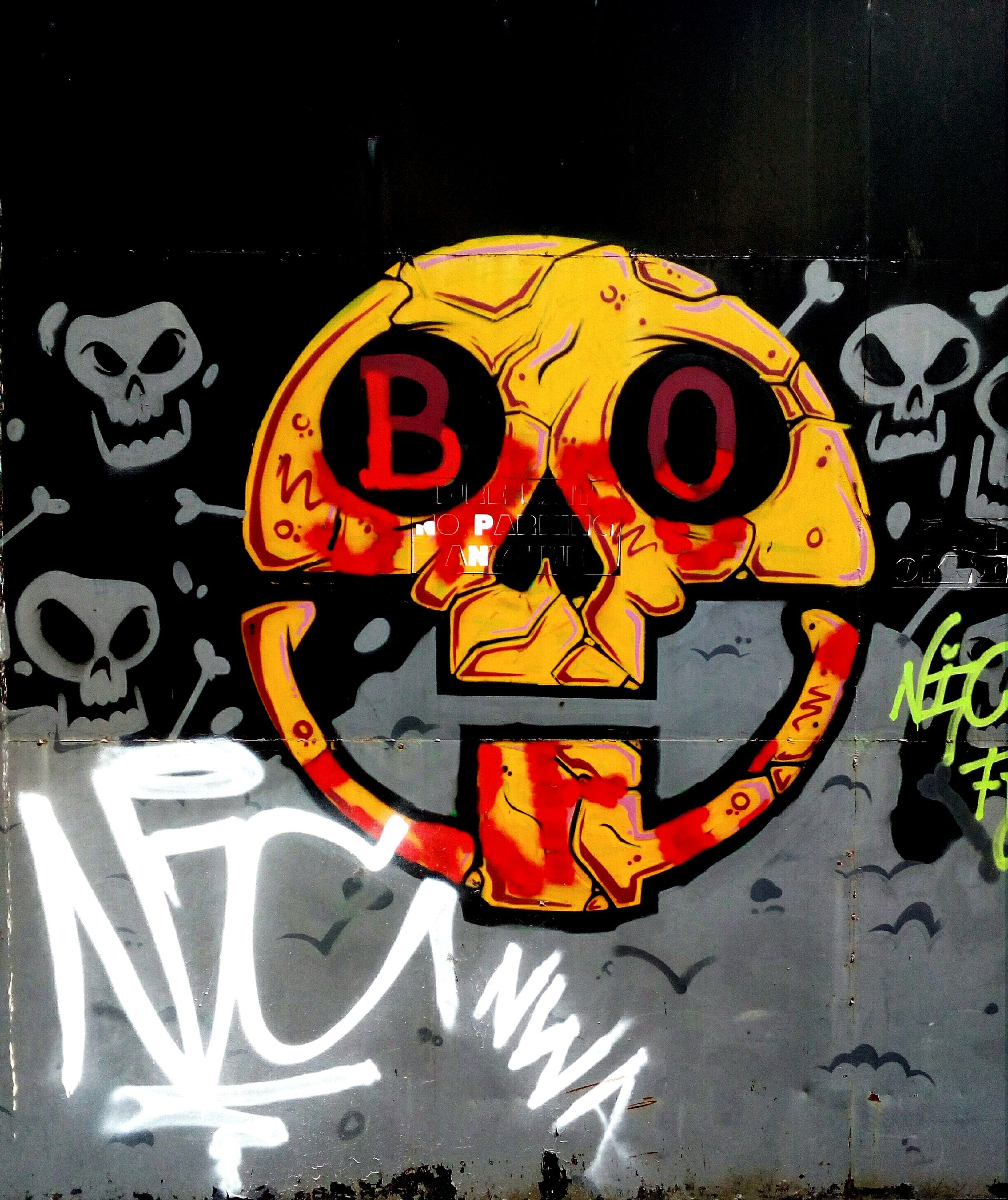 night, graffiti, no people, halloween, outdoors, anthropomorphic face, multi colored, close-up, jack o lantern