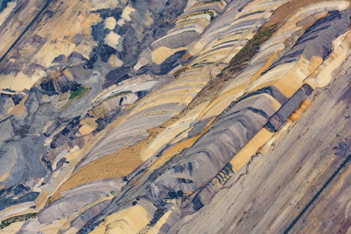 Bird's eye view of the Etzweiler mine. This hole in the earth, is as big a small city. A Bird's Eye View Abstract Colors Colourful Colours Earth Etzweiler EyeEm Best Shots From Above  Lines Mine No One No People Open Mine Open-cast Mining Open-cut Mining Open-pit Mining Polution Textures Backgrounds