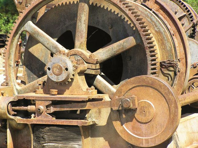 Circle Close-up Complexity Curve Day Electric Motors Empire Mine Focus On Foreground Full Frame Gear Gear Teeth Geometric Shape Grass Valley Iron - Metal Machine Part Man Made Object Metal Mining Equipment No People Outdoors Rivet Heads Rivets Weathered Wrought Iron