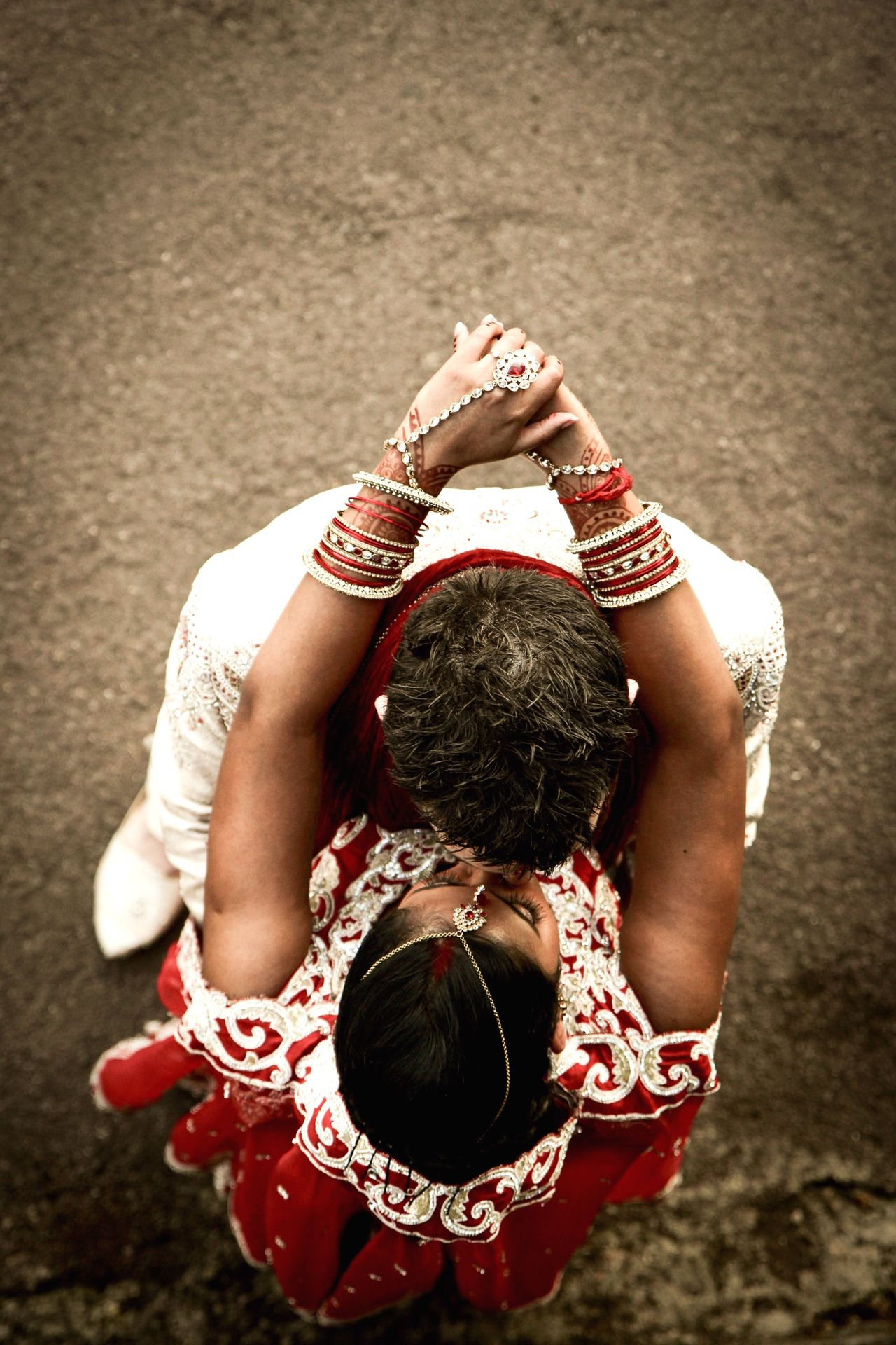 Kiss Elevated View Wedding Wedding Photography Indian Indian Wedding Couple Man And Woman Bride And Groom Saree Jewellery Different Perspective EyeEm Red White Fine Art Photography Bangles Showcase July A Bird's Eye View Art Is Everywhere
