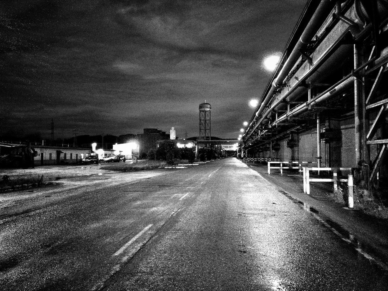 Gloomy night view in the factory. After The Rain Black&white Blackandwhite Photography Building Exterior Deserted Deserted Factory Eyeem Industrial View Factory Night View Getting Creative Gloomy Weather Industrial Landscape Industry Night Lighting Night Working Nightphotography Perspective Road Sad Night Scene Showcase: January Street Light The Way Forward