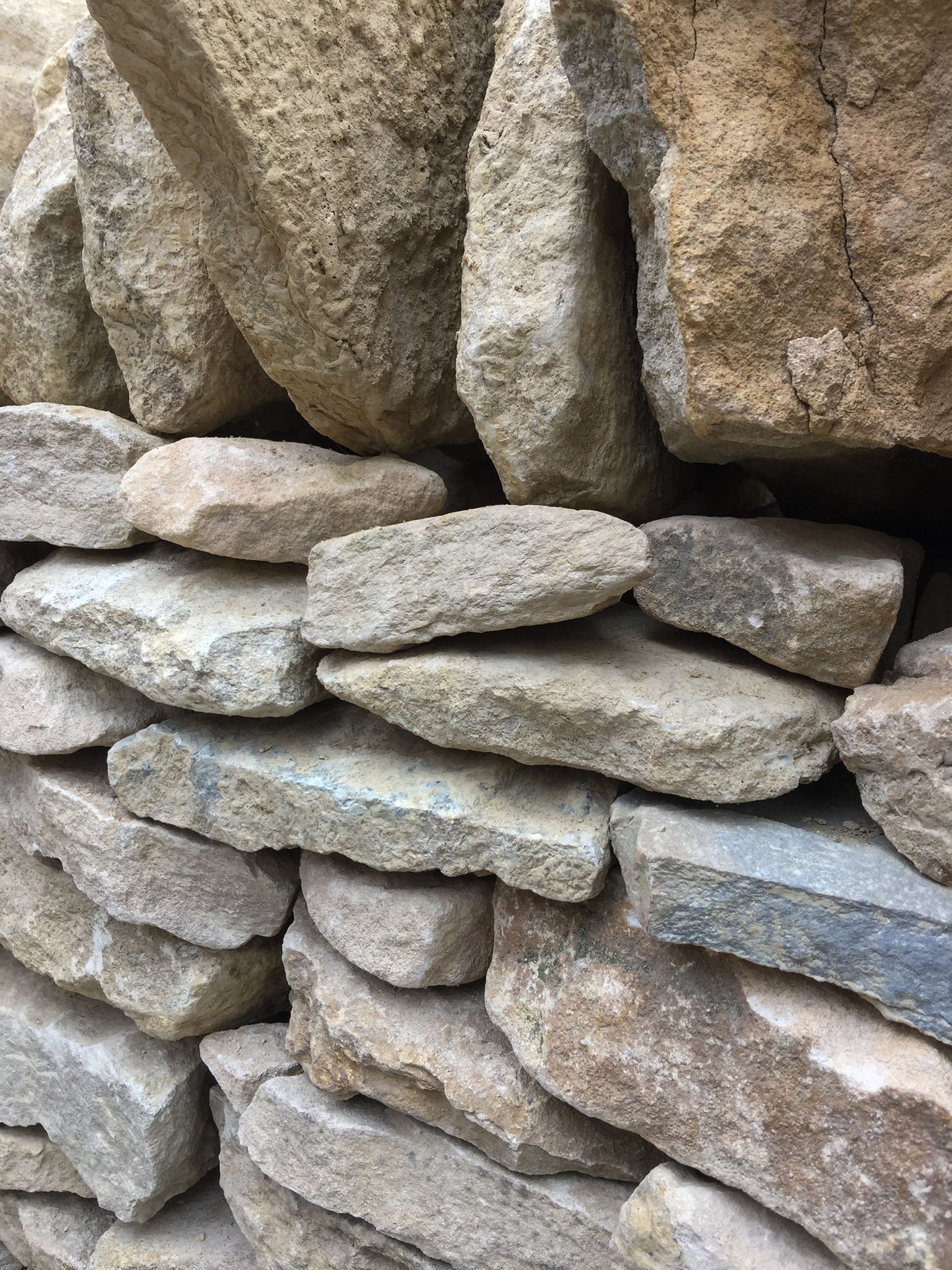 Closeup of an old stone wall (no mortar). Architecture Stack Wall Close-up Day No People Outdoors Stack Stone Wall - Building Feature