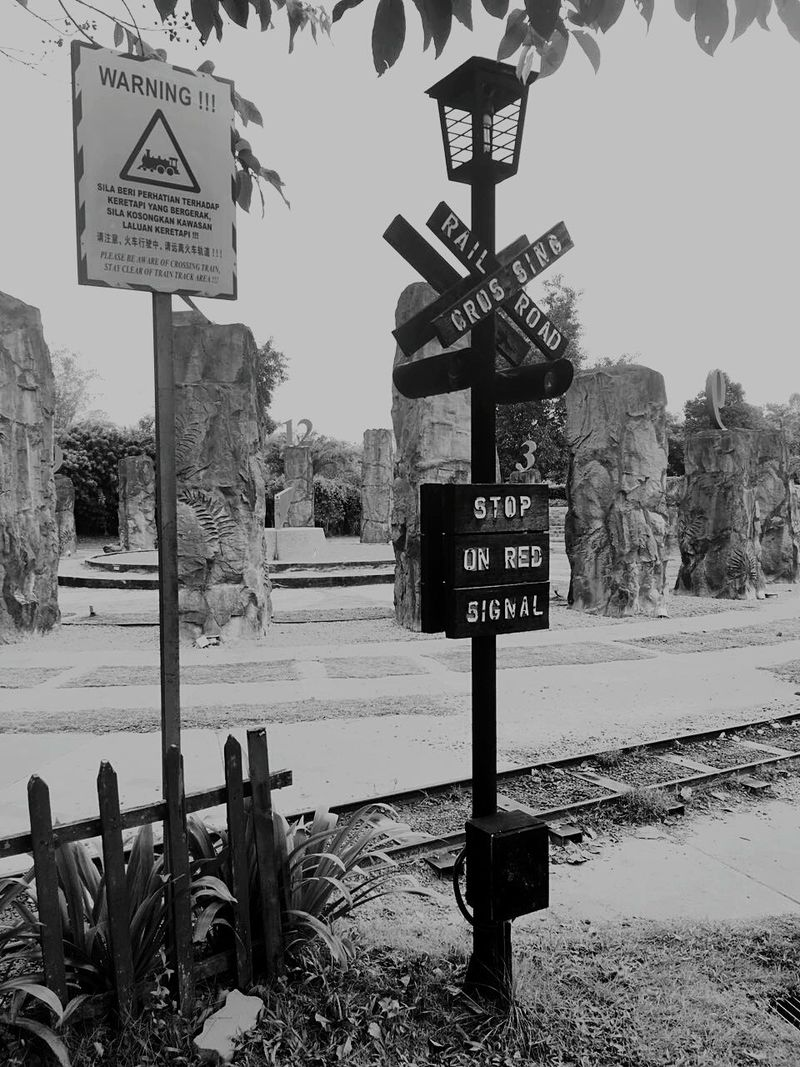 Text Communication Road Sign Outdoors No People Day Tree Sky Railway Black And White Photography Black & White No Logo No Logos