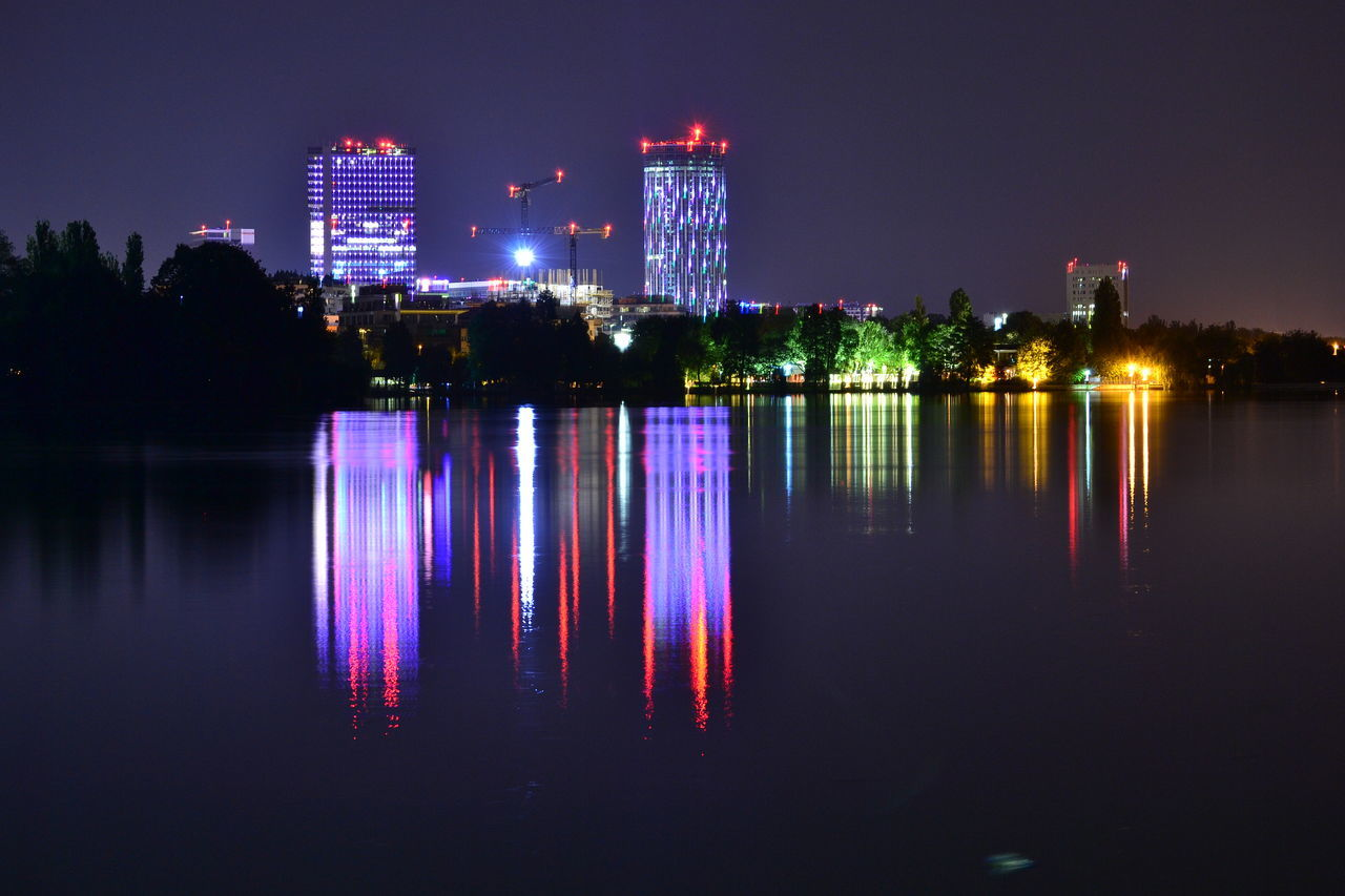 Architecture Awesome Beautiful Bucharest Building Building Exterior Business City Cityscape Illuminated Lake Modern Multi Colored Neon Night Reflection Sky Skyscraper Tower Urban Skyline Water Waterfront