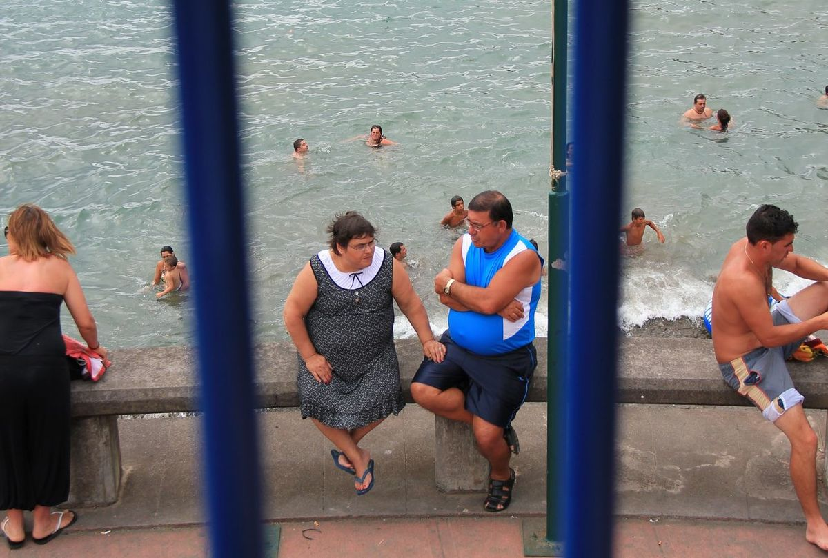 Swimming behind Bars Beach Casual Clothing Day Full Length Large Group Of People Leisure Activity Lifestyles Manandwoman Person Steps People And Places São Miguel - Açores Ribeira Quente Old And Young Looking To The Other Side Boulevard Vacation Swimming Togetherness👫👭 Togetherness Vacations Waiting Contrasts Balcony View
