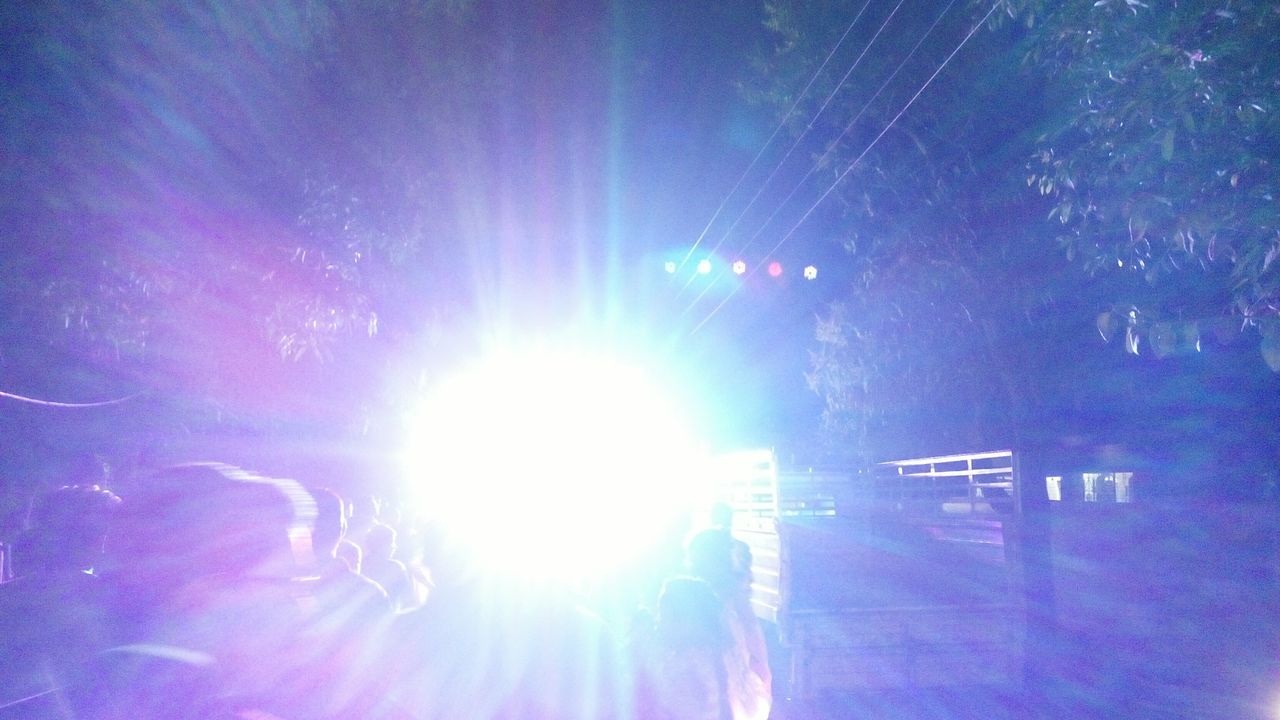 Illuminated Disco Light At Night