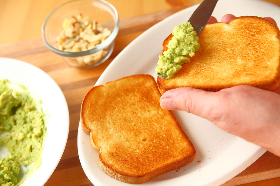 Preparing avocado toast point of view Almonds Avocado Toast  Bread Slices Breakfast Close-up Fingers Food Preparation Freshness Hand Healthy Eating Holding Home Food Homemade Food Indoors  Kitchen Skills Man Mashed Food One Person Overhead Snack Tasty Textures Toasted Bread Vegetables