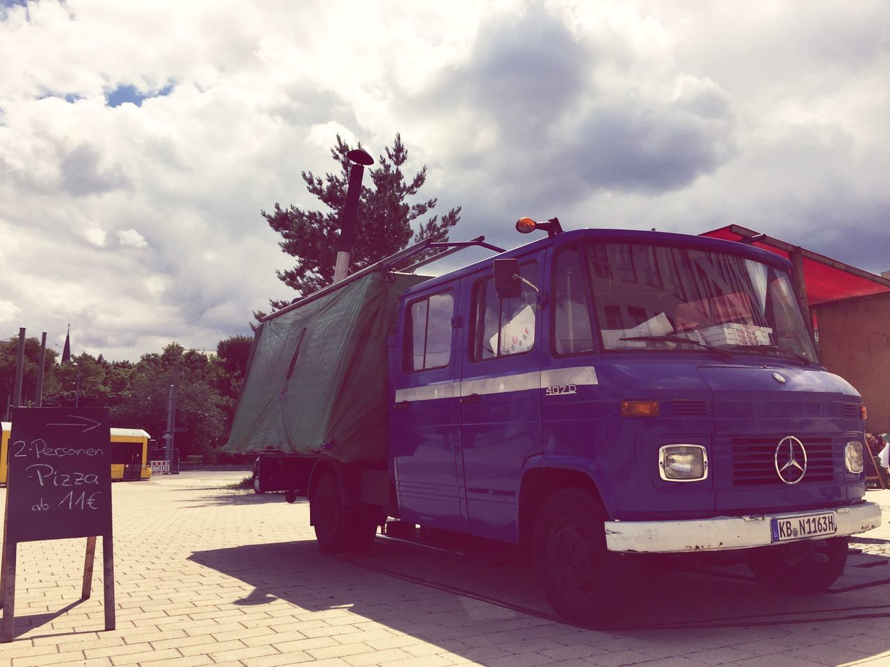 The Mercedes of street pizza Sky Cloud - Sky Day Tree Outdoors No People Architecture Pizza The Street Photographer - 2017 EyeEm Awards Pizza Time Pizzalover Street Food Street Food Worldwide Street Food Vendors Mercedes Mercedes Truck Truck Oven Oven Pizza Steinhof Blue Truck Farmers Market The Street Photographer - 2017 EyeEm Awards
