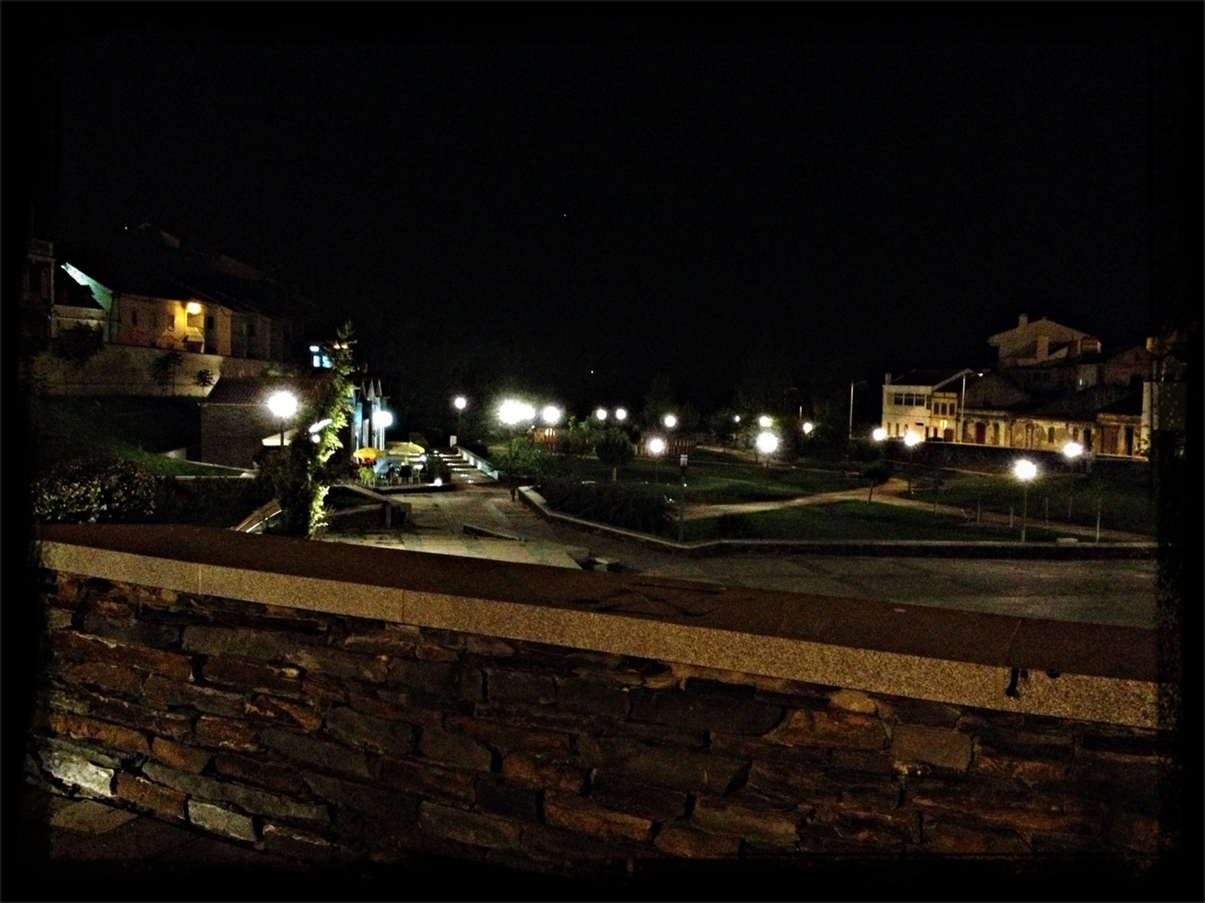 night, illuminated, building exterior, built structure, architecture, street light, lighting equipment, clear sky, copy space, dark, house, street, outdoors, no people, sky, old, city, light - natural phenomenon, residential structure, residential building