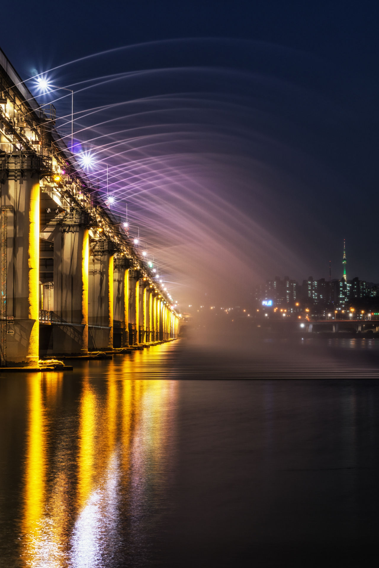 banpo bridge fountain show at night in seoul, south korea Banpo Bridge Bridge Bridge - Man Made Structure Built Structure Connection Engineering Fountain Show Korea Landmark Light Show Night Night View Pier River Seoul Seoul, Korea Suspension Bridge Travel