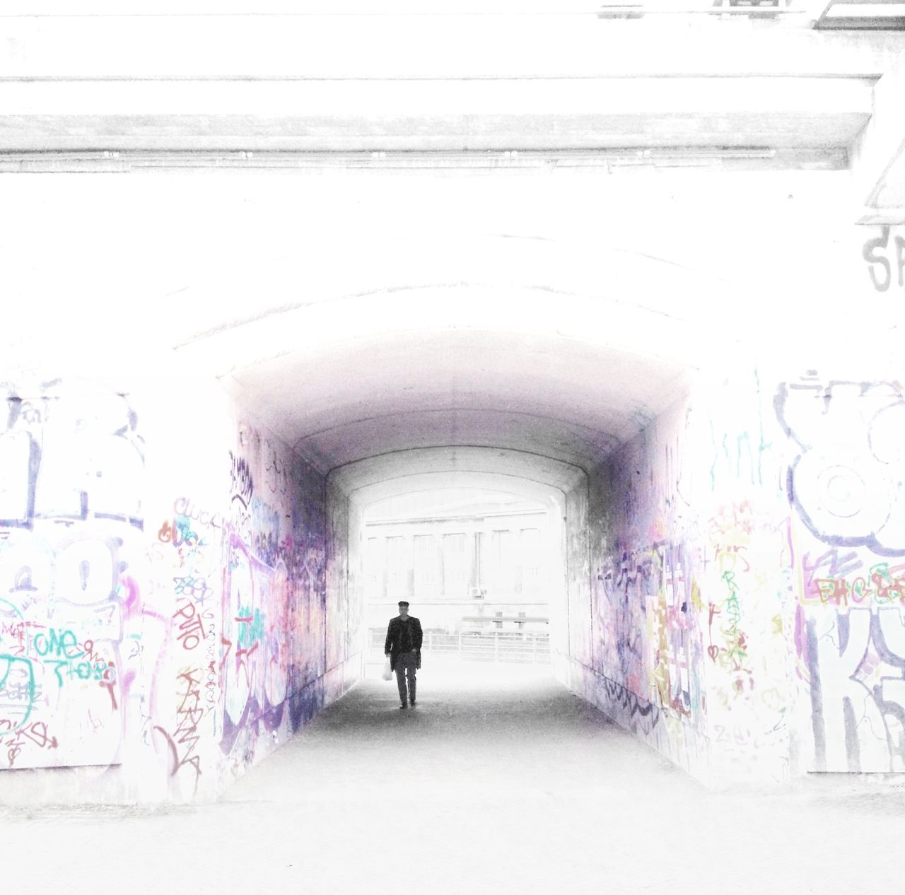 graffiti, architecture, one person, art and craft, built structure, multi colored, full length, street art, silhouette, real people, tunnel, men, day, indoors, people