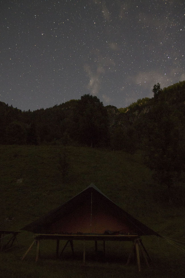 """A night spent """"sleeping"""" between the mountains... Astronomy Beauty In Nature Camping Canon 1100D Dark Hiking Idyllic Infinity Lifestyles Light And Shadow Night Outdoors Remote Soul Searching Space Star Star - Space Stars Sublime Tent Tranquil Scene Tranquility Traveling Tree Camp"""