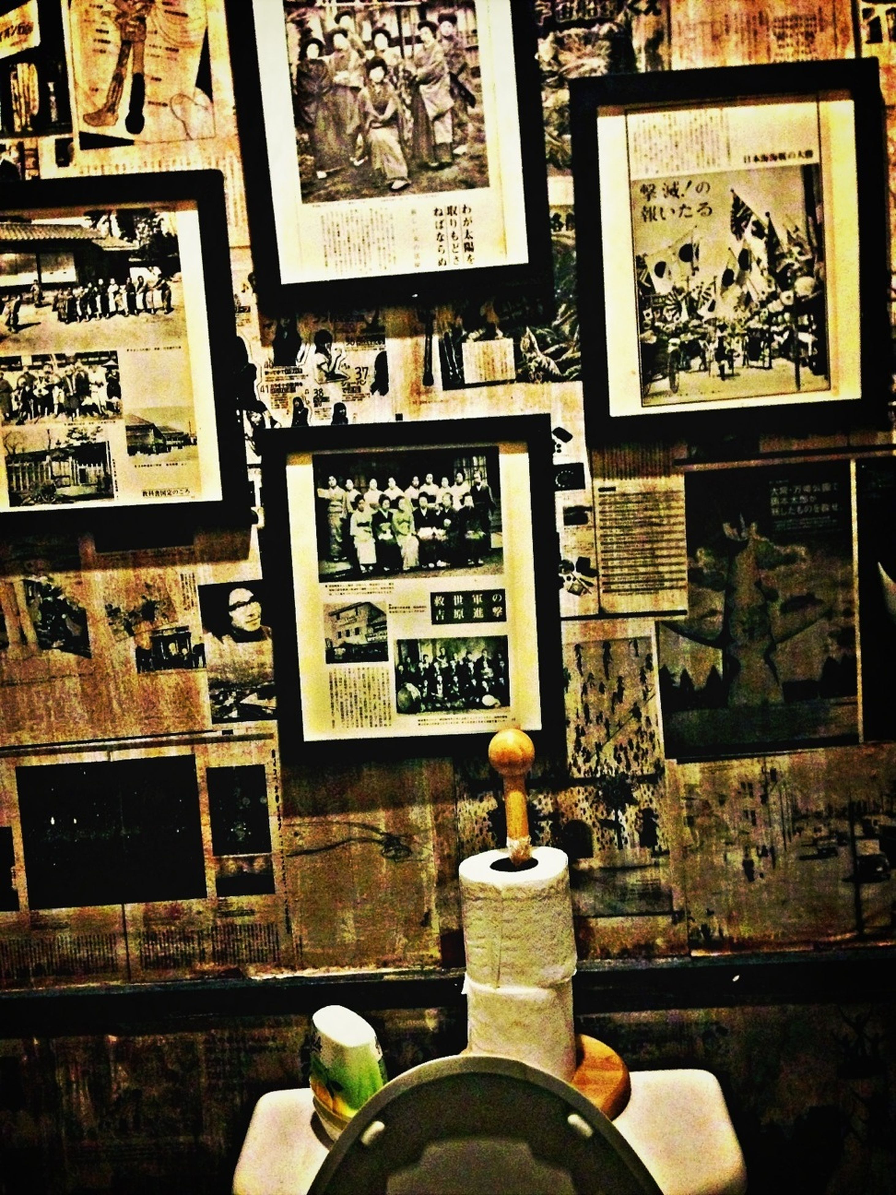 indoors, old, art, art and craft, text, old-fashioned, communication, high angle view, human representation, creativity, wall - building feature, memories, metal, retro styled, day, part of, history, the past, spirituality