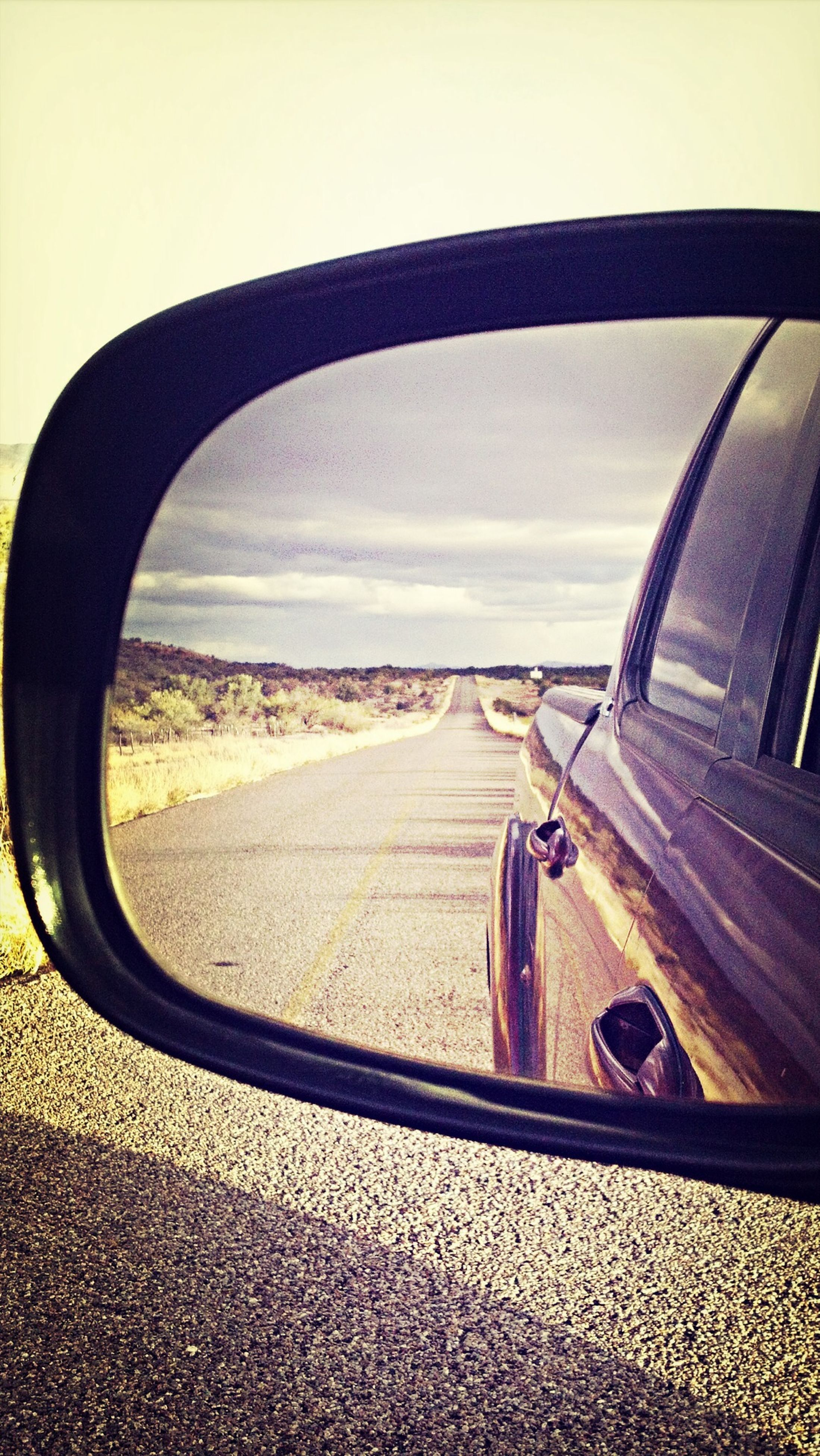 transportation, land vehicle, mode of transport, sky, road, car, side-view mirror, street, landscape, window, sunlight, travel, day, vehicle interior, close-up, on the move, glass - material, part of, outdoors, bicycle