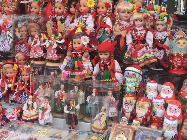 Arrangement Art Art And Craft Choice Creativity Figurine  For Sale Human Representation Idol In A Row Indoors  Large Group Of Objects Market Multi Colored Place Of Worship Polish Heritage Religion Repetition Retail  Sculpture Shop Spirituality Statue Temple - Building Variation