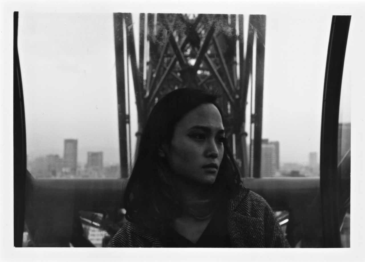 We all are perfect at the moment. Monochrome Photography Filmphotography Portrait Filmcamera Monochrome City 35mm Film 35mmfilmphotography First Eyeem Photo People Loneliness A Girl Eyes Blackandwhite Black White Asian  Japan OSAKA Beauty Young Woman Woman Portrait Cıty Ferris Wheel