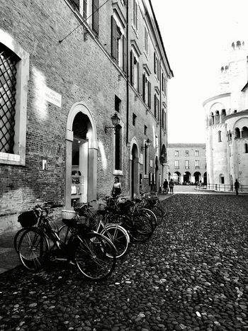 Impatto. Cicling Unites Bicycle City Big City Life Outdoors Architecture Streetphotography HuaweiP9 Modena Piazza Grande Bnw Bnw_captures Miles Away