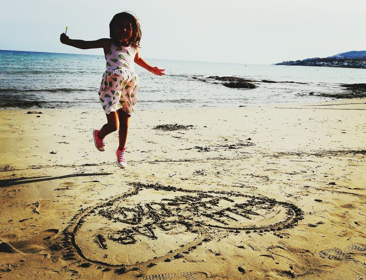 Beach Sand Child Sea Joy Outdoors Horizon Over Water Vacations Fuerteventura Beach Girl Lollipop First Eyeem Photo