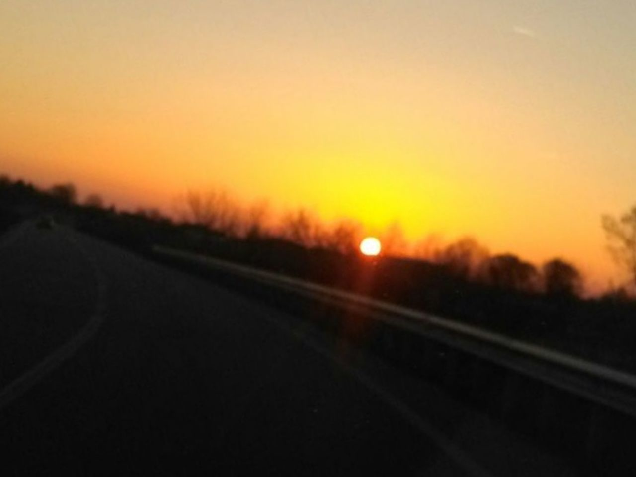 sunset, transportation, orange color, scenics, nature, road, sun, no people, beauty in nature, landscape, outdoors, tranquil scene, sky, railroad track, journey, silhouette, tranquility, day