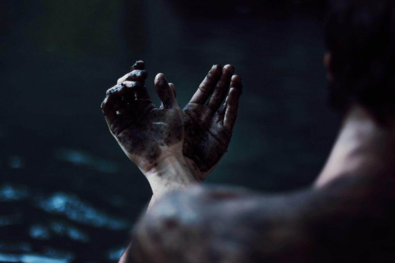 Close-Up Of Man With Dirty Hands