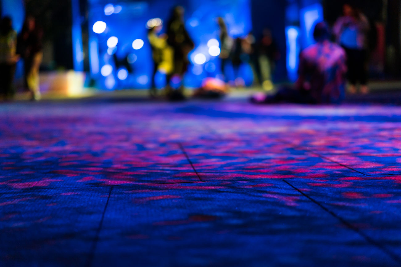 Close-up Focus On Foreground Illuminated Incidental People Low Section Men Night One Person Outdoors People Real People Selective Focus