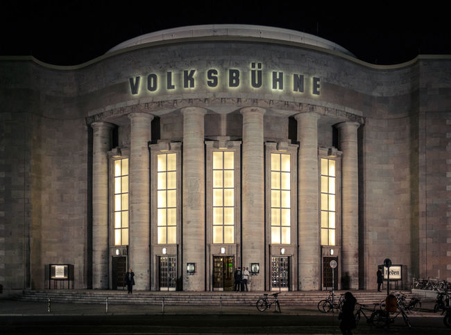 """The Volksbühne (""""People's Theatre"""") was built in 1913/1914. In the last years it has been establishing a reputation as one of the most provocative and experimental major theaters in contemporary Germany Architectural Column Architecture Berlin Berlin Mitte Berlin Photography Culture Façade Famous Place Frontal Shot Historical Building History Night Night Photography Theater Travel Destinations Western Script"""