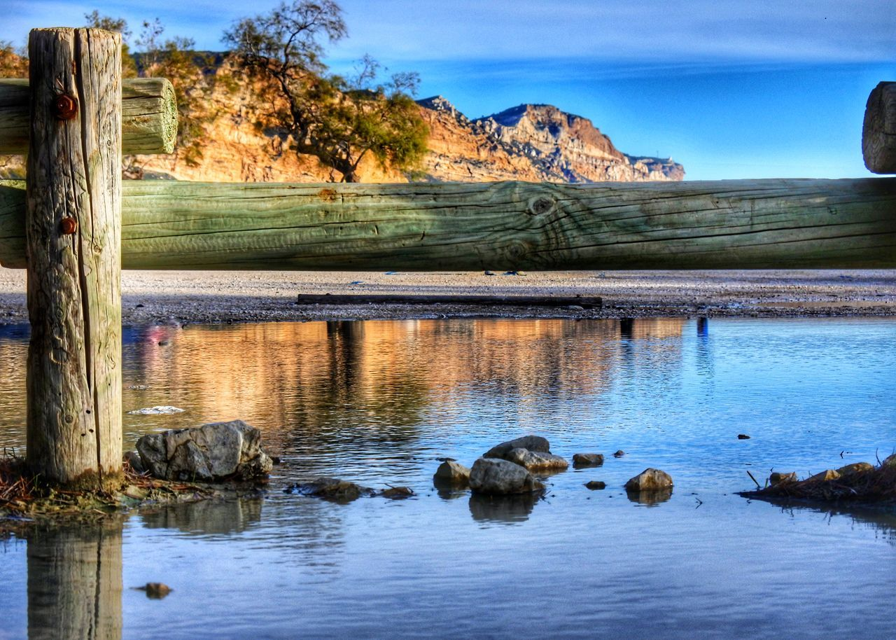 water, lake, reflection, nature, rock - object, beauty in nature, scenics, day, no people, tranquil scene, tree, outdoors, tranquility, sky, landscape, travel destinations, animals in the wild, animal themes, mountain, mammal