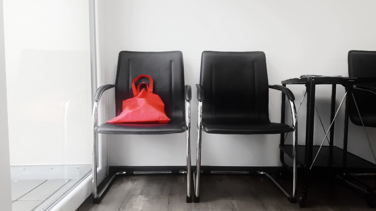 Indoors  No People Red Day Chairs Waiting Room Waiting Bag Leather Still Life Interior Interior Design Interior Views Forgotten Things Forgotten Directly Below Doctors Office Doctor's Office Red Bag Window Daylight