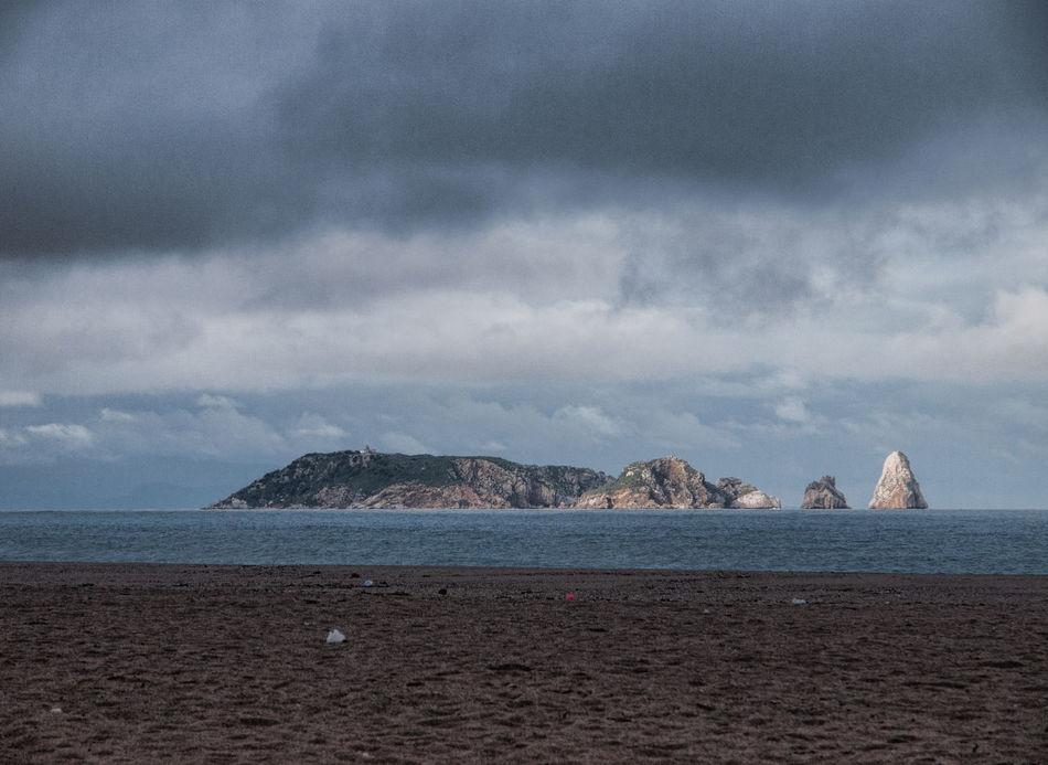 The island Beach Cloudy Sky Island No People Outdoor Pals Rocks Sea Tranquility