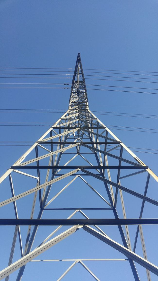 Connection Sky Transportation No People Metal Technology Cloud - Sky Vertical Outdoors Day Nature Close-up Transmitter Tower Power Lines Unique Perspectives View From Below Looking Up Metal Structure Electricity  Blue Grey Blue Sky No People,