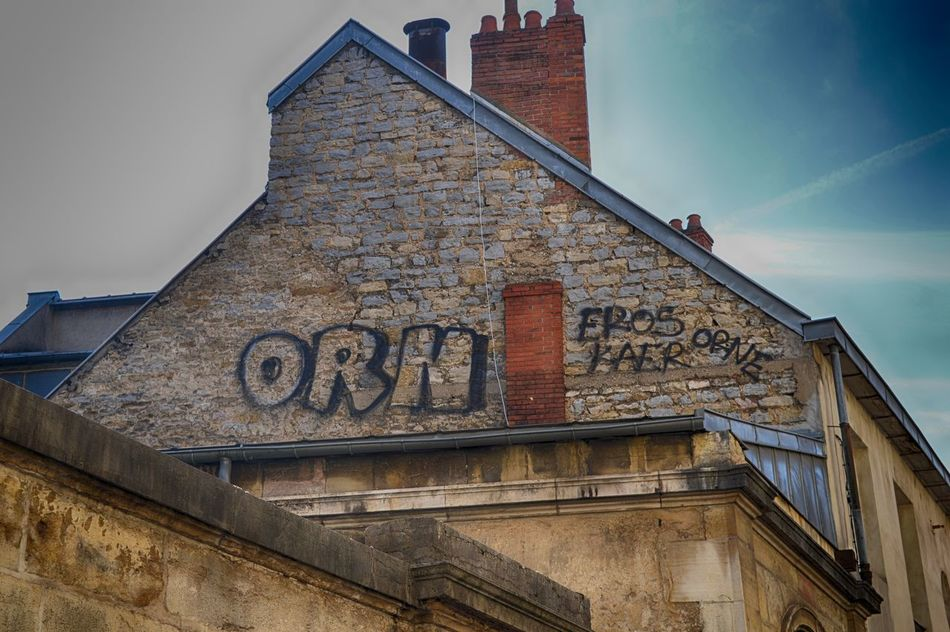 Architecture Art Blue Sky Brick Wall Building Exterior Built Structure Graffiti Low Angle View No People Outdoors Rooftop Sky Street Art Street Photography Urban Exploration