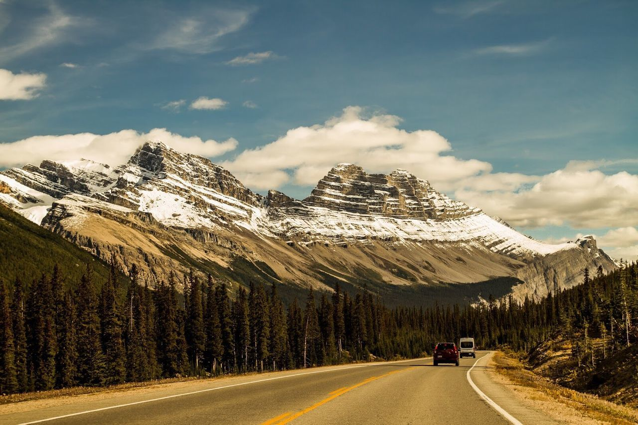 Last year in Canada. Mountain Range Beauty In Nature Outdoors Snow Landscape Nature Road Roadtrip Canada Cloud - Sky Cold Temperature Street Canonphotography Canon 70d Mountain Rocky Mountains