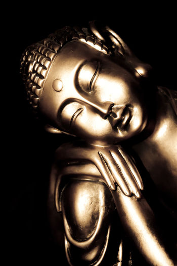Relaxed golden buddha statue with a black background Art Product Black Background Blackandwhite Buddha Buddhism Close-up Creativity Golden History Human Representation Indoors  Isolated Man Made Object Meditation Peaceful Relaxed Relaxing Single Object Still Life Studio Shot Thai