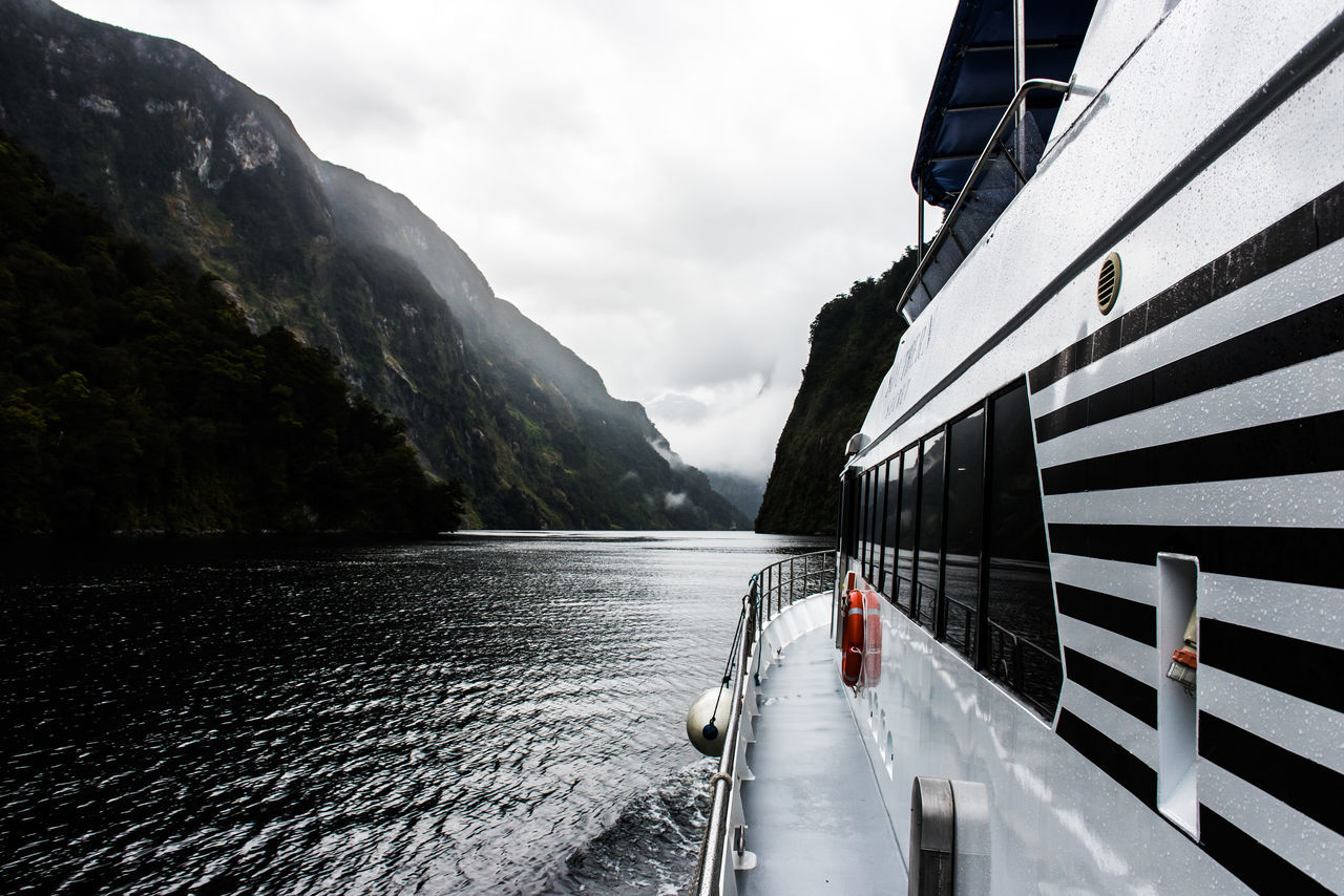Aquatic Sport Beauty In Nature Black Water Boat Deck Cloud - Sky Day Doubtful Sound Mountain Nature Nautical Vessel New Zealand New Zealand Beauty New Zealand Scenery No People Outdoors Sky Sound Of Life Travel Destinations Vacations Water EyeEmNewHere