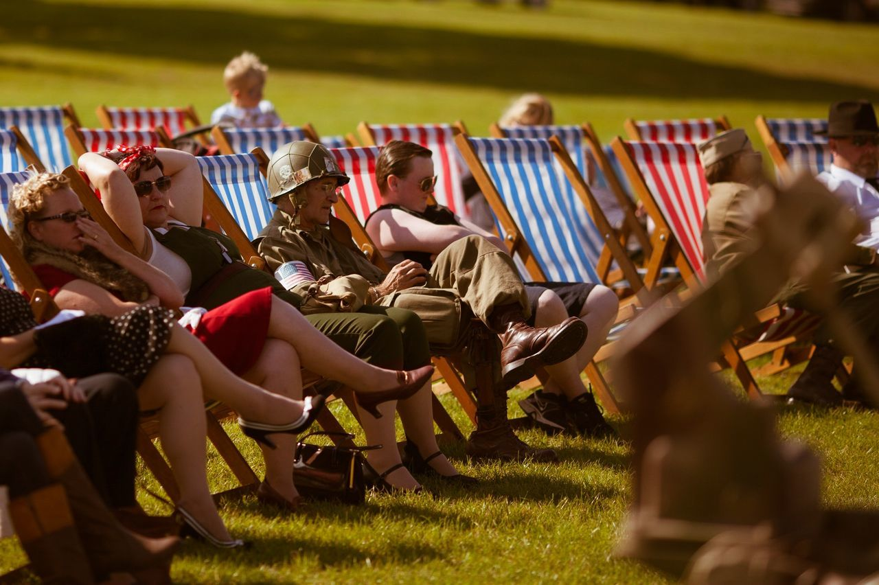 real people, sitting, grass, togetherness, women, leisure activity, men, large group of people, day, lifestyles, full length, outdoors, people