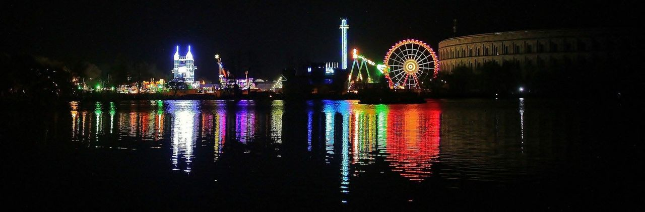 illuminated, night, reflection, water, built structure, building exterior, architecture, long exposure, river, waterfront, travel destinations, no people, ferris wheel, city, outdoors, multi colored, sky, cityscape