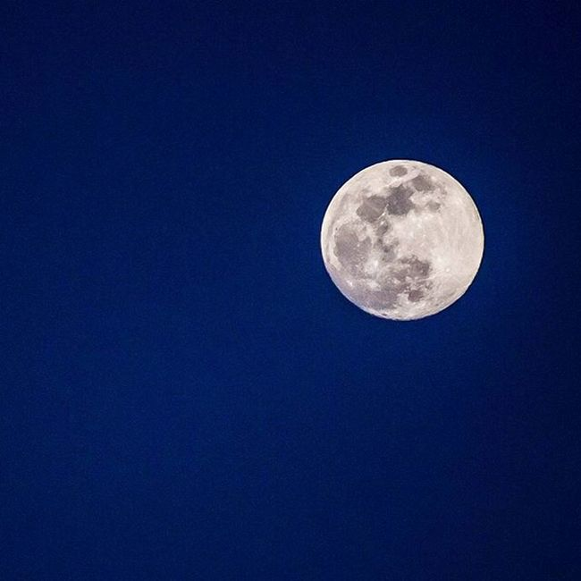 Moon floating in a deep blue sky right after sunset. I've done plenty of full moon photos, but the color of they sky in this is something I can't get enough of. Moon Moonlight Deepblue Bluehour Sky Utah Fullmoon Nightsky Visitutahvalley