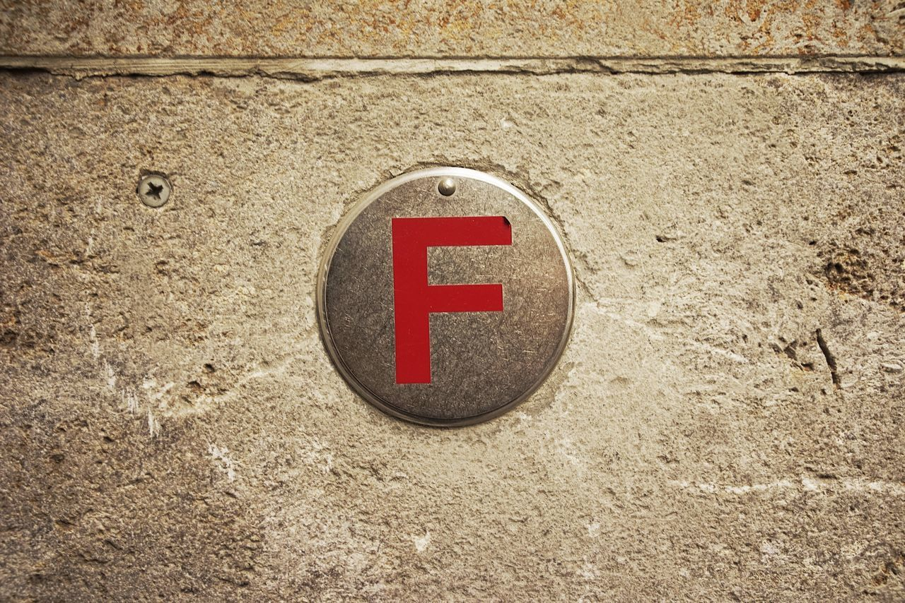 Close-Up Of Letter F On Wall