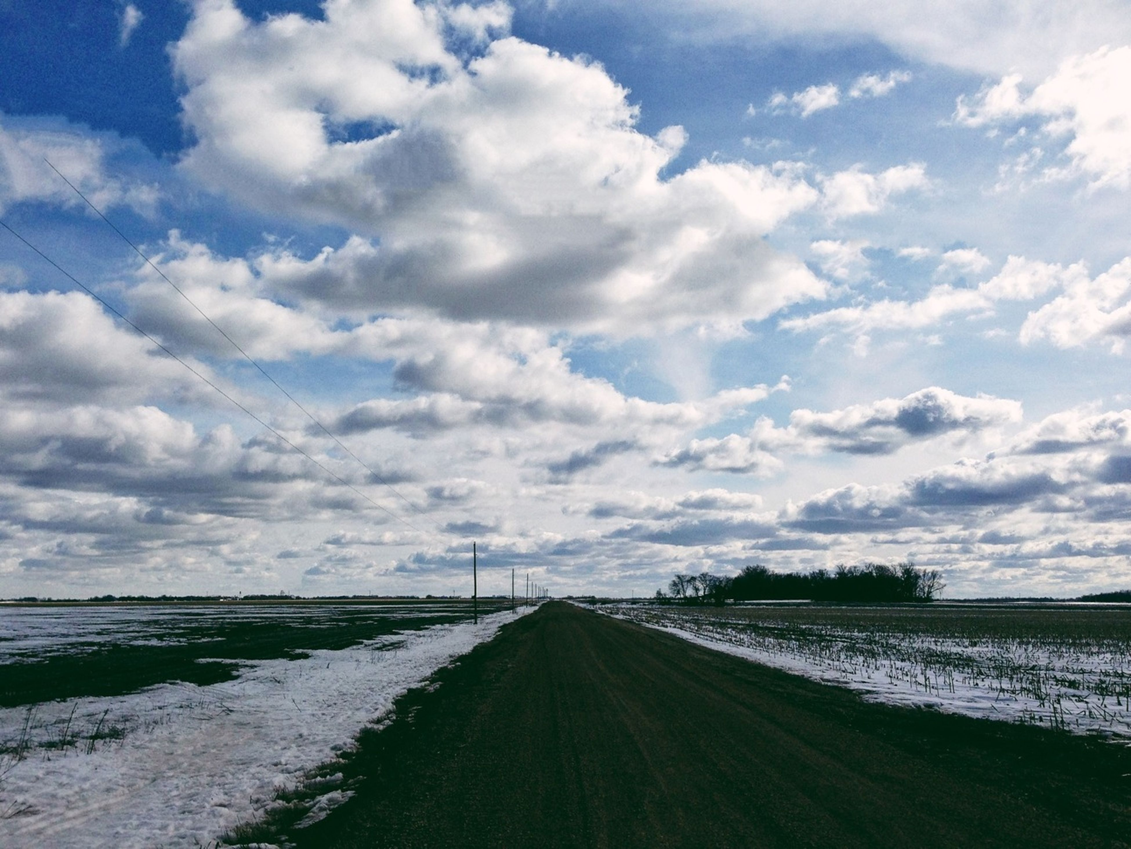 sky, water, cloud - sky, the way forward, tranquil scene, tranquility, cloudy, cloud, sea, scenics, nature, beauty in nature, diminishing perspective, road, landscape, vanishing point, transportation, day, no people, outdoors