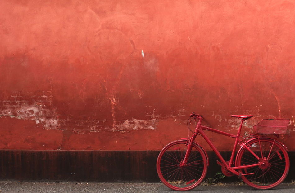 Bicycle City Composition Copyspace Empty Parked Red Red Bicycle Red Wall Same Color Scraped Paint Single Color Unusual Urban Wall