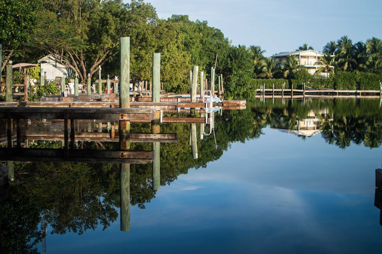 reflection, water, tree, day, outdoors, built structure, waterfront, lake, architecture, no people, sky, moored, nature, nautical vessel, building exterior