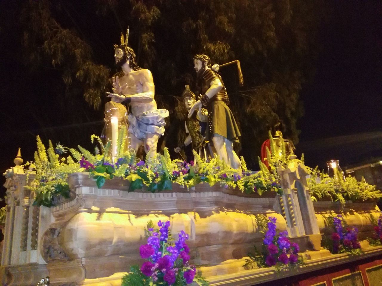 statue, sculpture, human representation, male likeness, art and craft, creativity, fountain, flower, night, outdoors, travel destinations, water, no people, tree, sky