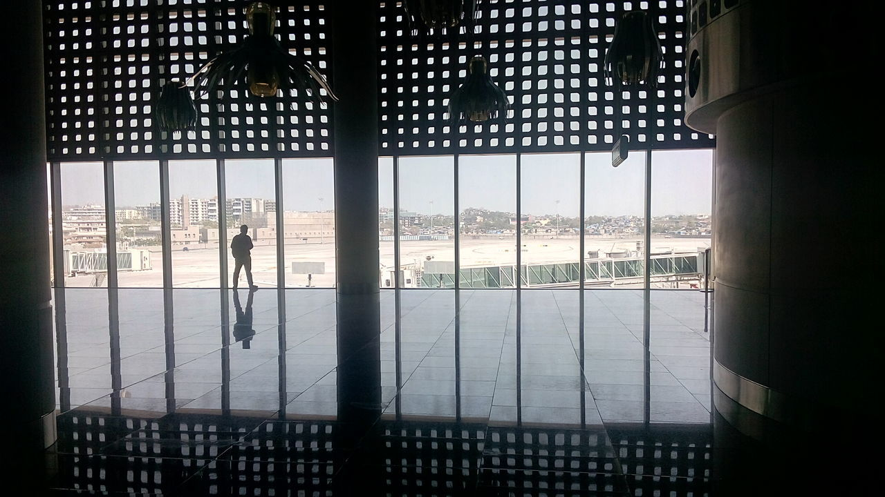 window, indoors, real people, reflection, silhouette, architecture, built structure, day, looking through window, one person, water, sky, people