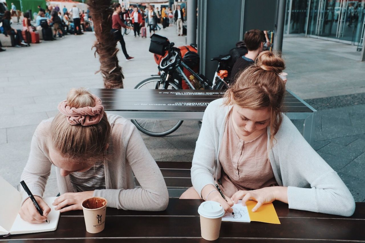 Sitting Women Togetherness Lifestyles Casual Clothing Day Adult Real People Convenience Young Women Young Adult People Adults Only Sisters