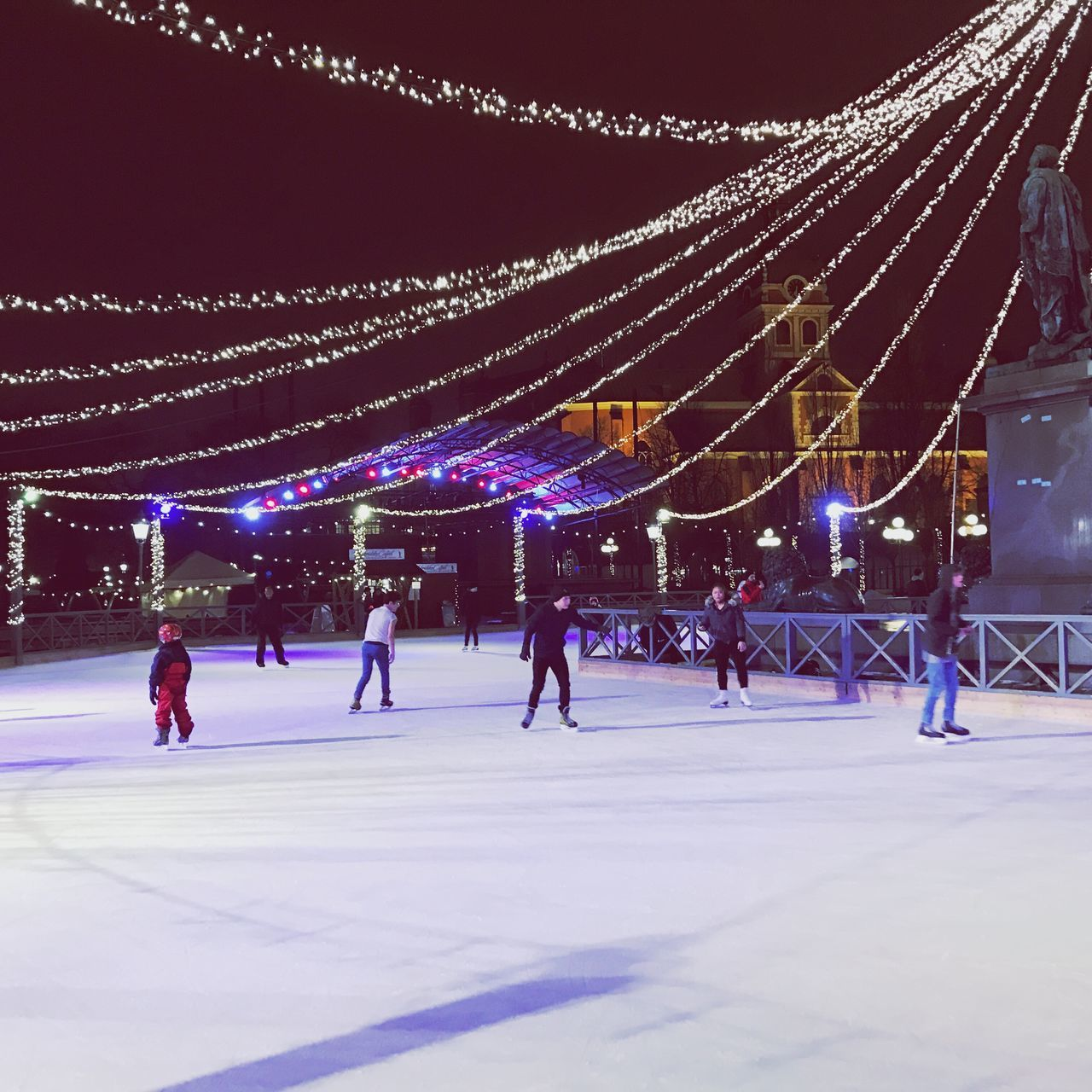 Ice-skating Night Lights Winter Cold Temperature Illuminated Snow Real People Ice Rink Ice-skating Leisure Activity Ice Skate Outdoors Men Large Group Of People Night Sky