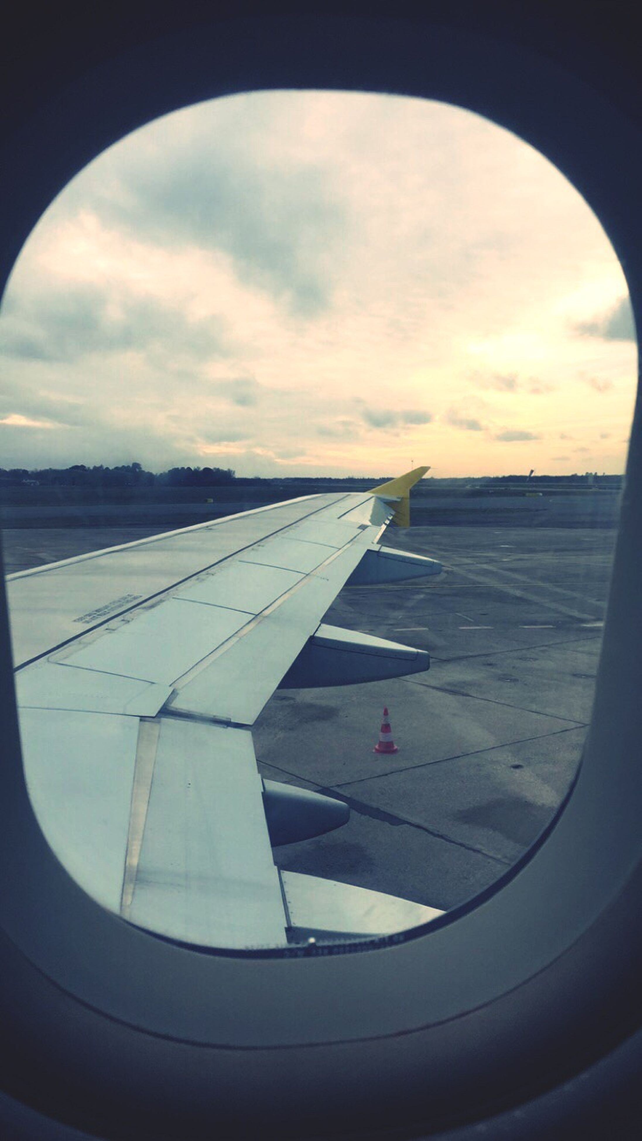 transportation, airplane, sky, air vehicle, cloud - sky, mode of transport, flying, part of, aircraft wing, cropped, cloud, window, vehicle interior, cloudy, glass - material, transparent, mid-air, travel, nature, landscape