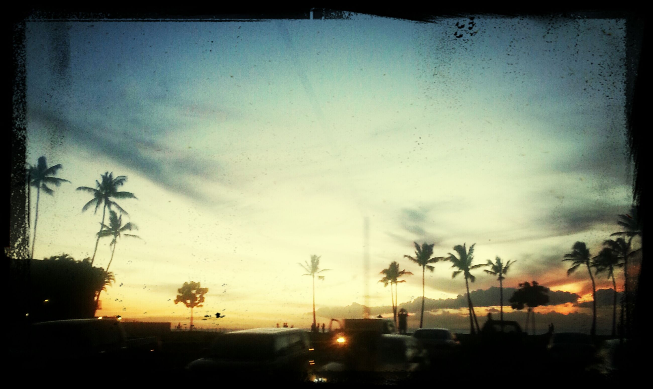 sunset, silhouette, transfer print, sky, car, transportation, tree, land vehicle, auto post production filter, cloud - sky, mode of transport, road, street light, dusk, palm tree, street, cloud, beauty in nature, nature, cloudy